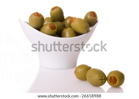 Green olives isolated on a white background (focus on the three olives)