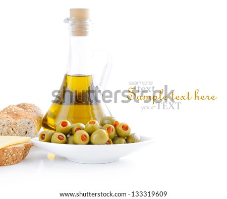 Green olives, oil, slices of bread are on a white background