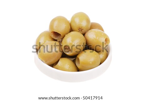 Green olives on a white plate isolated
