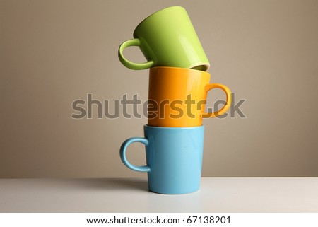 green orange and blue cup