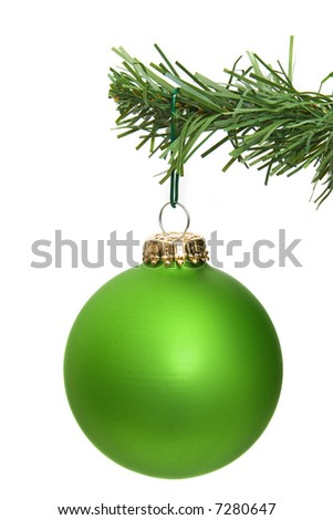 green ornament hanging on a pine tree branch