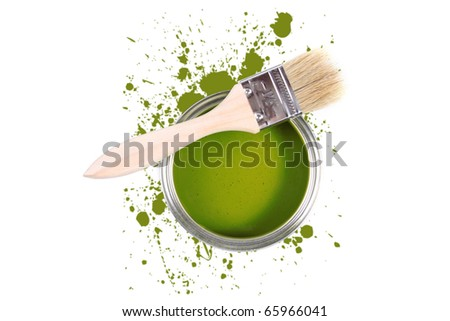 green paint can with brush and color stains
