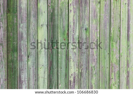 Green painted old wooden plank wall
