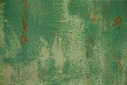 Green painted textured rusty aged metal background.