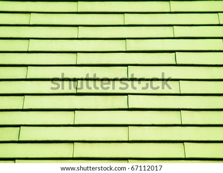 Green painted tin roof shingles