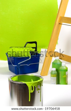 Green painting with ladder, roller brush, bucket and green pigments