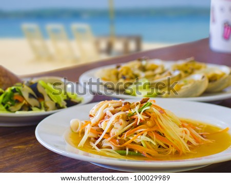 green papaya salad mixed with sea food, thai food