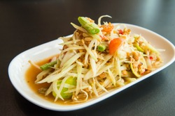 Green papaya salad on the table in the restaurant.