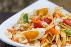 green papaya salad with salted egg thai food, Thai cuisine