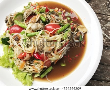 green papaya spicy salad with boiled Cockle