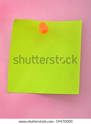 Green paper and push nail on purple background