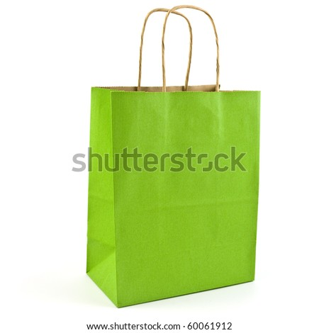 Green paper bag with handles isolated on white background in square format with copy space