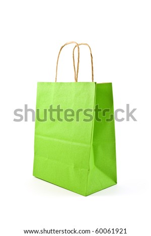 Green paper bag with handles isolated on white background in vertical format with copy space