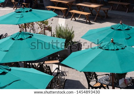 green parasols outside a cafe #1454893430
