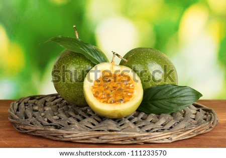green passion fruit on bright green background close-up