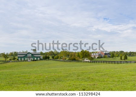Green pastures of  horse farms - stock photo