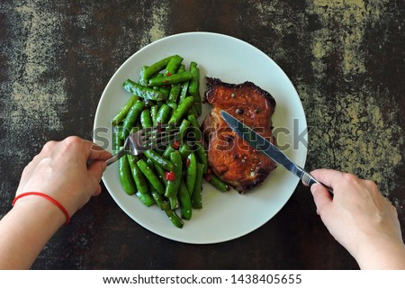 Green pea pods with chili pepper and soy sauce. Meat steak. An example of a balanced diet. Keto diet. Pegan Diet. #1438405655