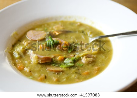 Green pea soup with sausage and vegetables