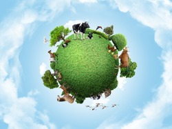 Green peace earth, miniature planet, globe concept showing a green, peaceful and animals poultry life