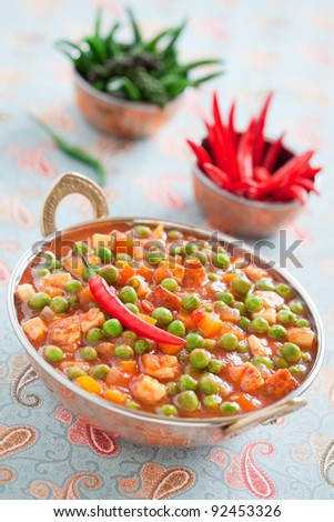 Green peas and paneer cheese in a spicy tomato sauce, selective focus