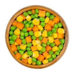 Green peas, corn and carrot cubes in wooden bowl. Mixed vegetables. Peas mixed with  vegetable maize, also called sugar or pole corn and with carrots cut in cubes. Closeup from above macro food photo.