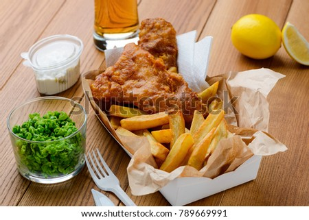 Green peas, fish and fries. Tasty and nutritious lunch in fast food restaurant. Traditional English food. #789669991