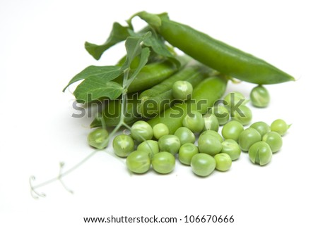 green peas on a white background - stock photo