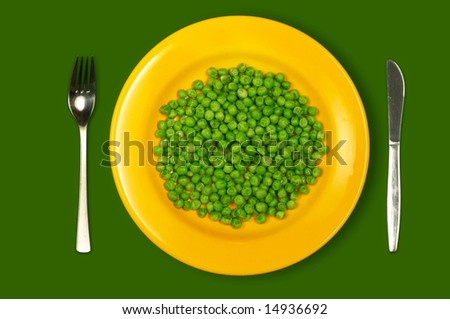 Green peas on yellow plate