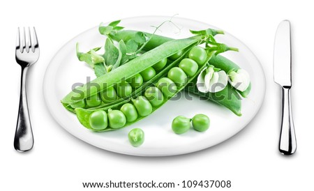 Green peas with pods on a plate. The image on white background.