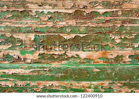 Green peeling paint on the wooden fence