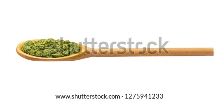 Green pesto sauce  in  wooden spoon isolated on white background,Green italian homemade  sauce #1275941233