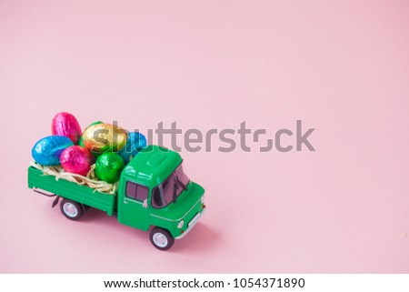 green pickup toy carrying...
