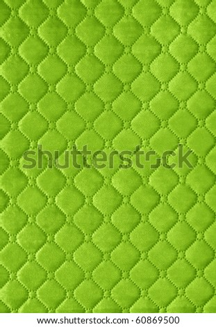 green picture of genuine leather upholstery - stock photo