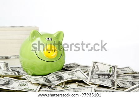 Photo of Green piggy bank on hundred of US dollars