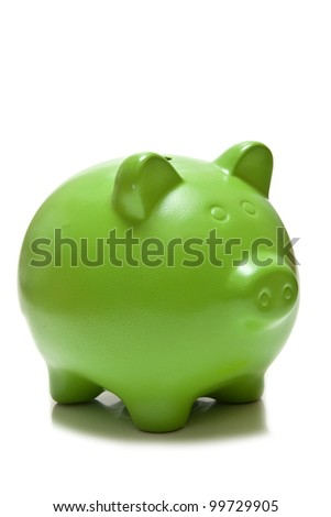 Green piggy bank or money box isolated on a white studio background.