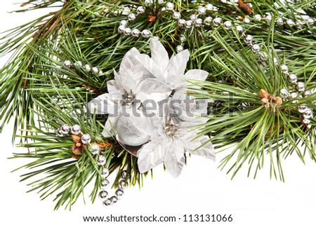Green pine branch with Christmas composition on white background