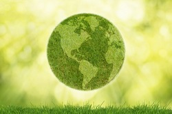 Green planet Earth with grass on green background