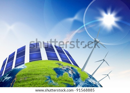 Green planet earth with solar energy batteries installed on it - stock photo