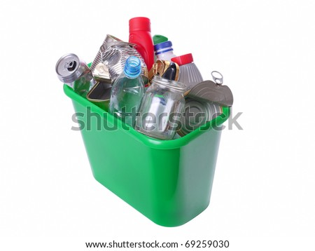 Green plastic trash bin filled with assorted domestic garbage - isolated on white background