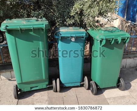 Green plastic trash cans in street Stok fotoğraf ©