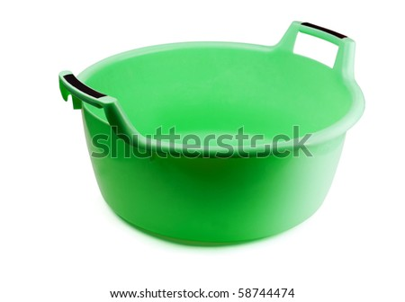 Green plastic washing bowl isolated on white
