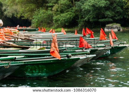 Green pleasure river paddle boats on the pier background #1086316070