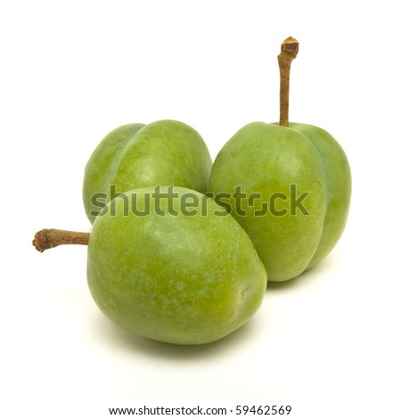 Green Plum from low perspective isolated against white.