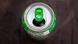 Green Pop Can Top of Soda Lid Wallpaper. Open Cola Tab and Refreshing Drink on a Hot Summer Day