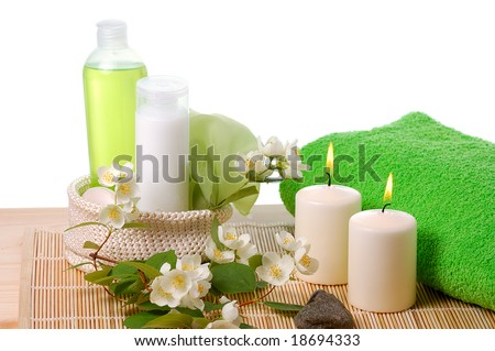 green products for spa with flowers of jasmin and white candles