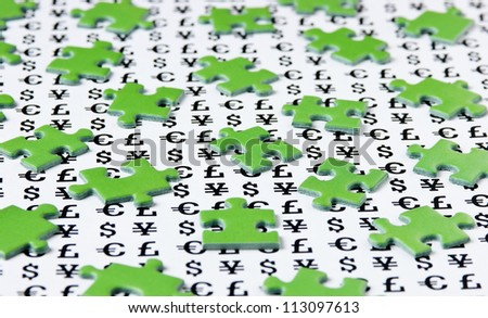 green puzzles and symbols of money