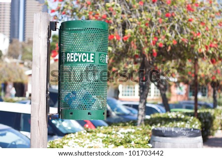 Green recycle bin in the park