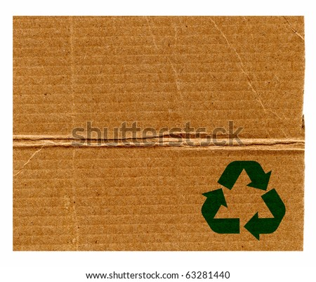 Green Recycle Symbol On Large Piece Of Cardboard Paper Isolated On White