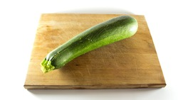 Green regular Zucchini, courgette on a wooden Cutting board - isolated