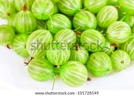 green ripe gooseberries isolated